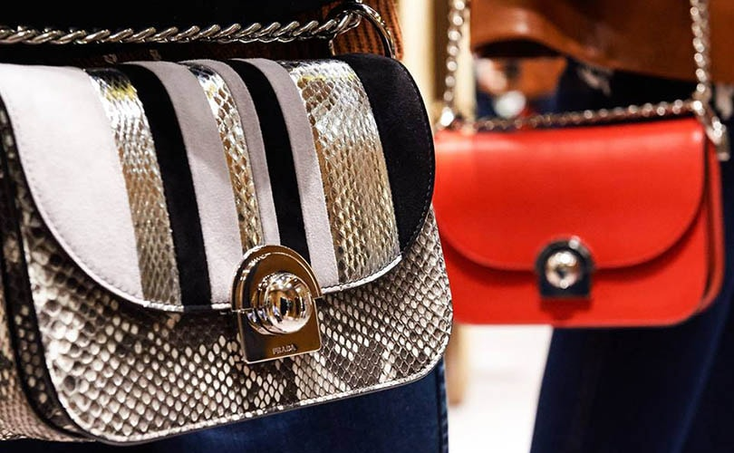 Prada to bolster e-commerce and retail in a bid to stem sliding profits