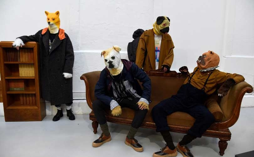 Men dressed as dogs & pigs at Paris Men's Fashion Week