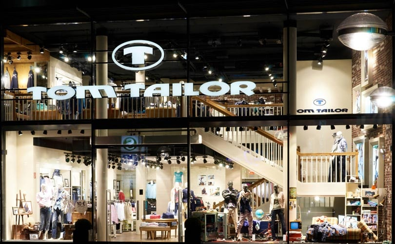 Tom Tailor lowers profit outlook, considers selling Bonita